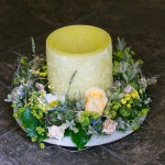Kerze mit Rosenkranz